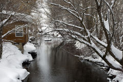 River at Gray Cliff. Peaceful scene of river and cabin in winter time royalty free stock photo