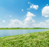 river in green grass and white clouds Royalty Free Stock Images