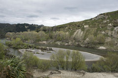 River between green hills. Beautiful river between green hills, North Island of New Zealand Stock Image