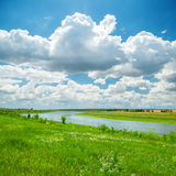 River in green landscape and blue sky Stock Photography