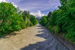 River with the green Trees and blue sky. Innsbruck stock photography