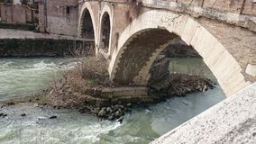 Tiber river with an ancient bridge in Rome, Italy Stock Photography