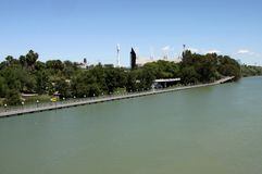 River Guadalquivir passing through the city of Seville. SEVILLE, SPAIN - JULY 17, 2011: River Guadalquivir passing through the city of Seville royalty free stock photography
