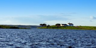 The river guadiana. River and island at the lake with rural house alqueva dam alentejo portugal stock images
