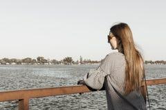 The girl admire the seascape. River harbor. The girl admire the seascape stock image