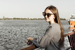 The girl admire the seascape. River harbor. The girl admire the seascape stock photo