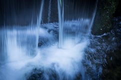 River during high water flow. Taken with a slow shutter speed to smooth out the flow of the water as is rushes by Stock Photography