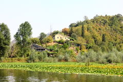 The river and the hill in Montenegro. The house on the river and near the hill in Montenegro Royalty Free Stock Images