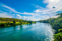River with hills sky background. stock images