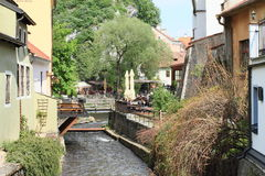 River among houses in Cesky Krumlov Stock Images