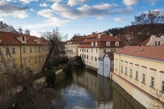 River and houses at Kampa, Prague, Czech republic. Watermill and old historical houses lining the small river at Kampa, Prague, Czech republic. Blue morning sky Royalty Free Stock Photos