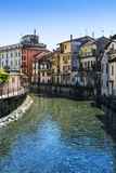 River and houses to Omega, Piedmont Royalty Free Stock Photography