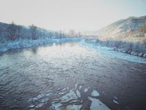 River with ice on a background of mountains stock images
