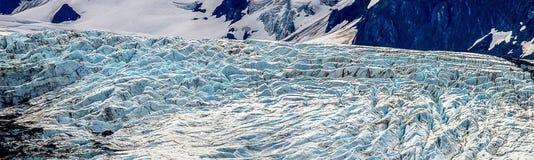 River of Ice. Panaroma of Portage Glacier sliding down mountain valley Stock Image