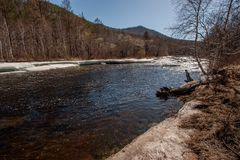 River with ice in spring stock photography
