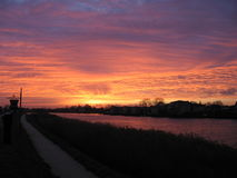 The river IJssel on fire. Sunrise on December 5th (Sinterklaas Day) over the river IJssel. Picture taken from Capelle aan den IJssel, at the Northern bank of the Royalty Free Stock Photo