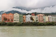 The river Inn and houses in Innsbruck, Tyrol, Austria. Royalty Free Stock Images