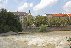 River isar with floodwater, historic old city munich Stock Photo