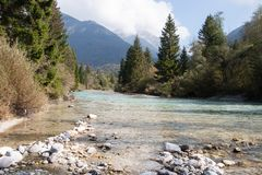 The bavarian river Isar flows through beautiful landscape royalty free stock photography
