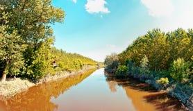 River in Italian Po valley running among fields Stock Photo
