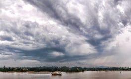 River Journey. Fishing boat crusing under a cloudy afternoon at Seri Malaysia Kuala Terengganu, Terengganu Malaysia Stock Photo