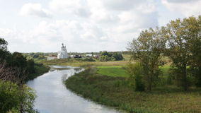 river Kamenka and Ilyinskaya church. Golden Ring Russia, Suzdal stock video footage