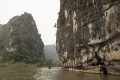 River and karst mountains. Nimh Binh, Vietnam. River surrounded by karst mountains in winter. Nimh Binh, Vietnam royalty free stock photography