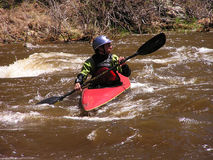 River Kayaker 2. Solo kayaker on the Cache la Poudre River near Fort Collins, CO Stock Photography