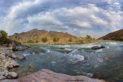 The rapid course of the river `Koksu`. Panoramic shooting. Nature `Zhetysu`, Kazakhstan. royalty free stock photo