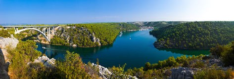 River Krka, bridge and town in Croatia Royalty Free Stock Image
