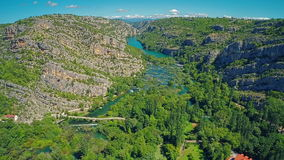 River Krka canyon. Copter aerial view of the river Krka canyon and water casdades stock video footage