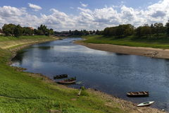 River Kupa in Sisak, Croatia. River Kupa and old brodge in Sisak by day, Croatia stock photography