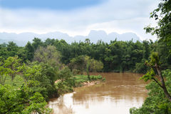 River Kwai. In flood with Mountains and forest Royalty Free Stock Photos