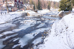River Labe Elbe with ice in winter in the ski areal Spindleruv Mlyn Royalty Free Stock Image
