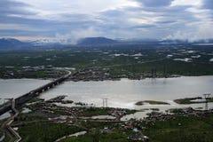 River, lakes and tundra near Norilsk metallurgical plant. The river, lakes and tundra near Norilsk metallurgical plant. The bridge over the river and boat royalty free stock photo