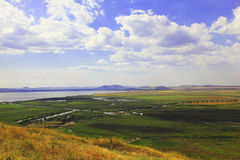 River landscape. Countryside landscape with river, plains and hills stock photography