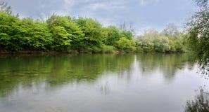 River landscape. The River landscape. The Spring rain Stock Photos