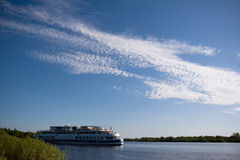 River landscape. With ship and fleecy clouds Stock Photography