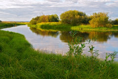 River landscape. The small river flows through water-meadows royalty free stock photo