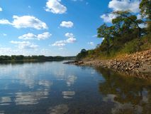 River landscape with clouds. River landscape with blue sky and clouds reflection and coast with trees Stock Image