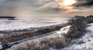 River landscape covered by fresh snow during Winter stock image