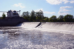 River landscape with dam and waterfall Royalty Free Stock Photography