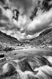 River landscape in drakensberg with dramatic clouds and mountain Royalty Free Stock Photography