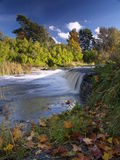 River landscape with falls in autumn Stock Images