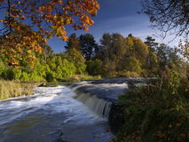 River landscape with falls in autumn Stock Photos