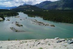 A river Landscape. A River flowing past the mountains Stock Photography