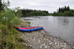 River landscape with kayaks. Stock Photos