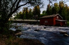 River landscape and old mill. Old mill at river Myllypuro, Finland. Shot at end of may 2018. There is trout and grayling in this river also Royalty Free Stock Image