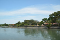 By the river. A landscape of a place by the river in singapore with blue skies and green tress Royalty Free Stock Photo