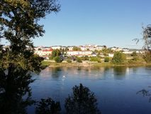 River landscape. And river beach, trees and village royalty free stock image